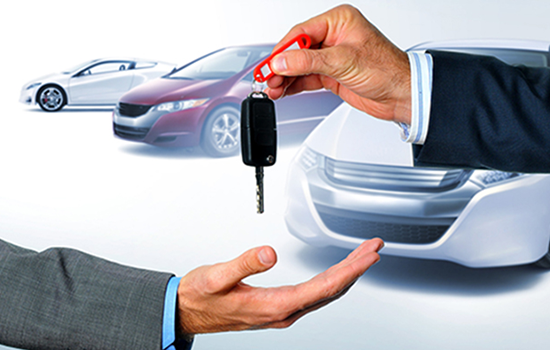 Car keys being provided at rent a car dealership