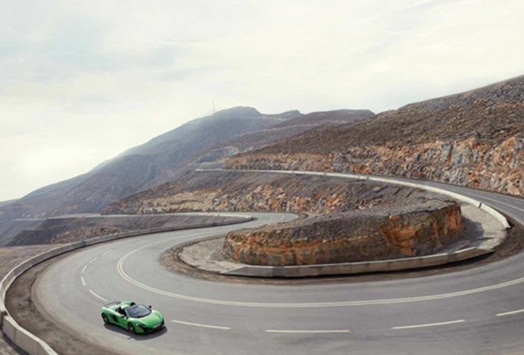 A green Supercar on the way up on Jebel Jais Road