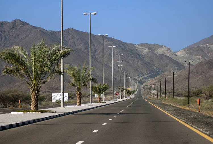 Beautiful Kalba road evening view covered with mountains on the side of the road.
